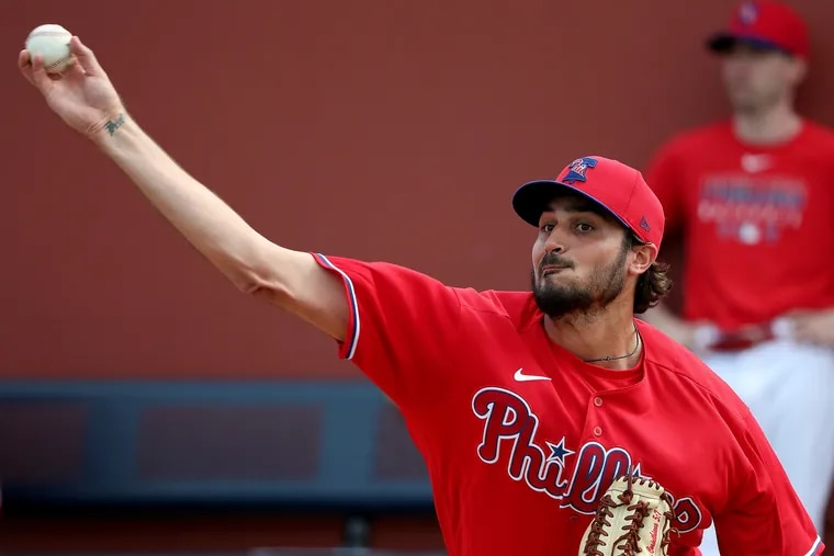 Zach Eflin pitches a bullpen session during Phillies spring training in Clearwater.