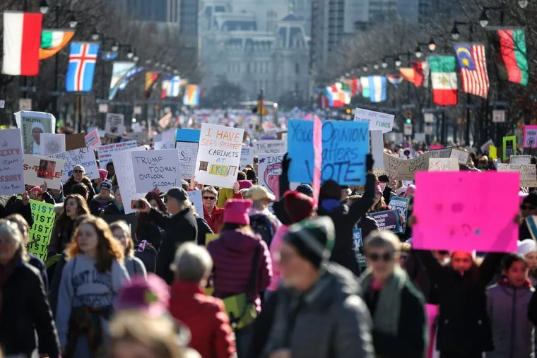 Marchers make their way up the Ben Franklin Parkway during the Women's March in Philadelphia.