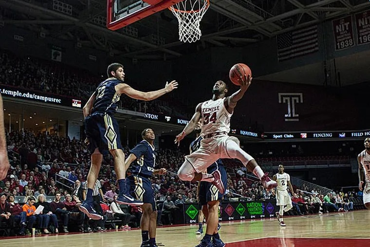 Temple's Devin Coleman jumps around defenders to put up two points. (Chris Fascenelli/Staff Photographer)