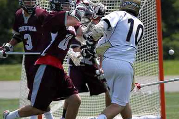 La Salle's Jack Bogorowski (10) scores in heavy traffic, but this year it was Conestoga beating the defending champs, 10-6.