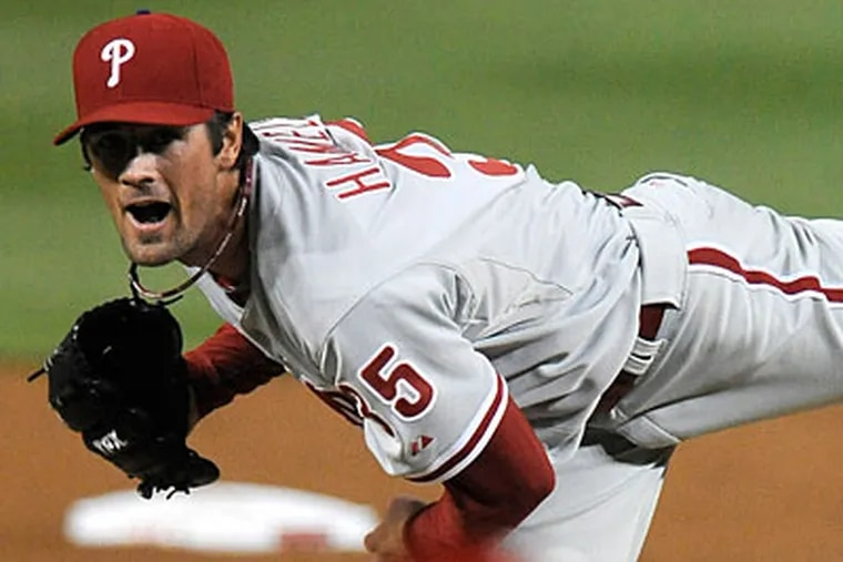Cole Hamels allowed just one run on five hits in eight strong innings against the Nationals. (Richard Lipski/AP)