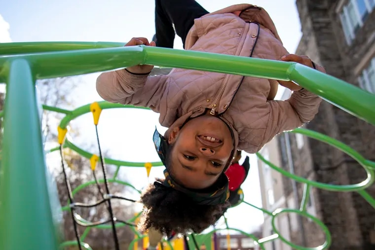 Samya Demercado, 7, a second grader at Overbrook Education Center, plays on the monkey bars on the new playground.  The Philadelphia School District elementary school, which educates the city's blind and visually impaired children as well as regular education students, had no playground until this year.