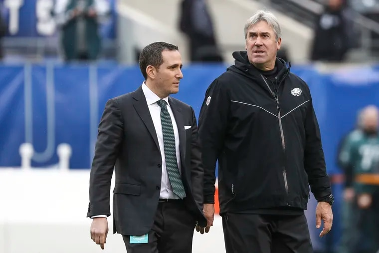 Eagles coach Doug Pederson walks with general manager Howie Roseman before a game against the New York Giants in December.