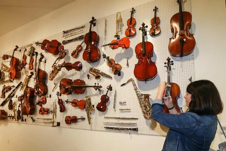 Art teacher Sunny Lee Mowery photographs broken instruments from Philadelphia public schools.