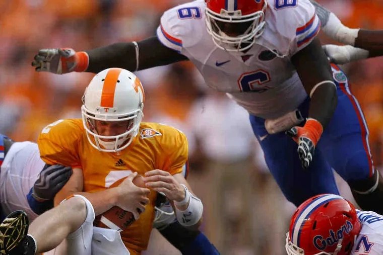 Tennessee QB Matt Sims (2) is caught from behind by Florida freshman Sharrif Floyd (obscured) in a Sept. 18 game.
