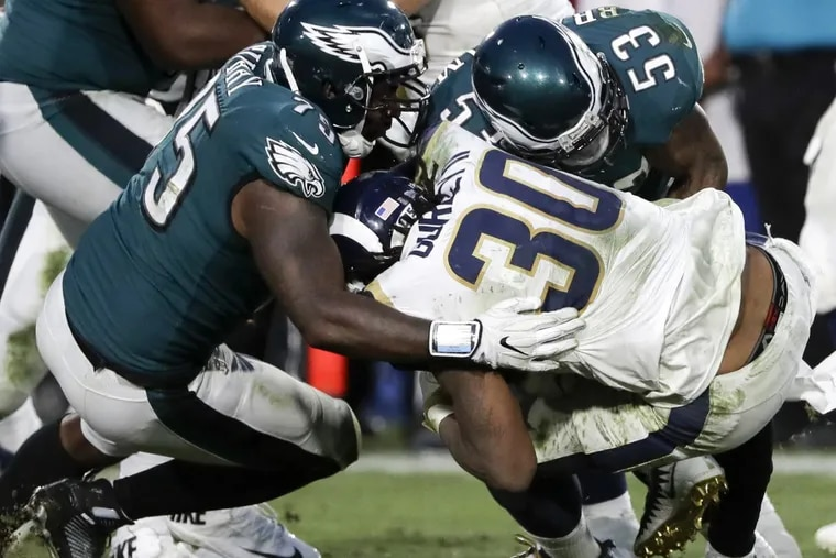 Eagles defensive end Vinny Curry and outside linebacker Nigel Bradham stops Los Angeles Rams running back Todd Gurley on Sunday, December 10, 2017. YONG KIM / Staff Photographer