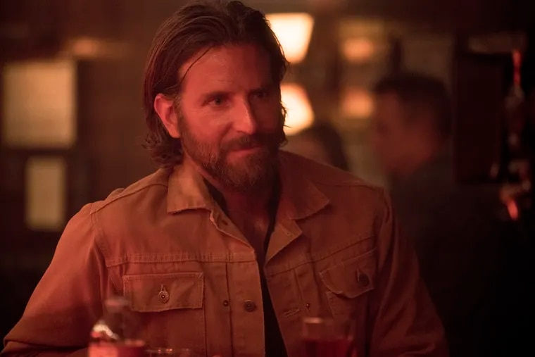 """This image released by Warner Bros. shows Bradley Cooper in a scene from the latest reboot of the film, """"A Star is Born."""" On Thursday, Dec. 6, 2018, Cooper was nominated for a Golden Globe award for lead actor in a motion picture drama for his role in the film. The 76th Golden Globe Awards will be held on Sunday, Jan. 6. (Clay Enos/Warner Bros. via AP)"""
