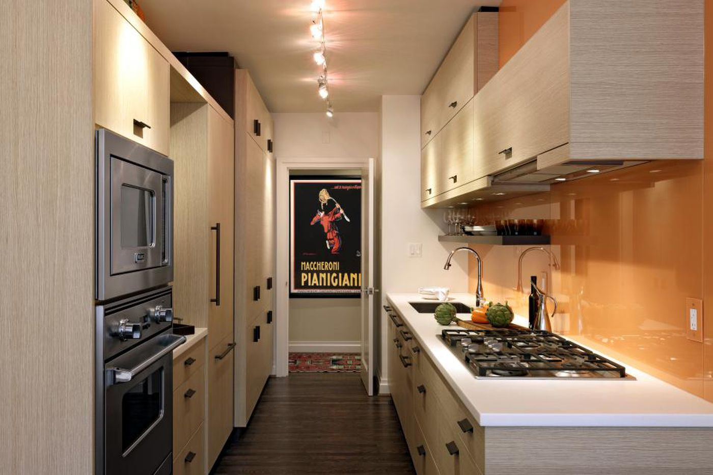 Sleek, simple galley kitchens compete with larger, eat-in spaces