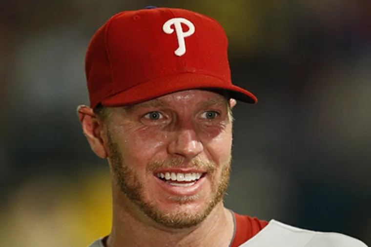 Roy Halladay smiles after throwing a perfect game in the Phillies' 1-0 win over the Marlins on Saturday. (AP Photo/Wilfredo Lee)