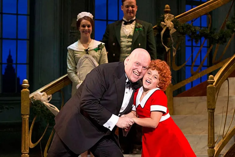 """The musical """"Annie"""" at the Academy of Music stars Issie Swickle in the title role and Gilgamesh Taggett as Daddy Warbucks. (JOAN MARCUS)"""