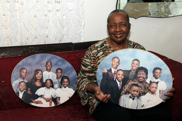Sharonell Fulton holds a photo of some of the children she has fostered.
