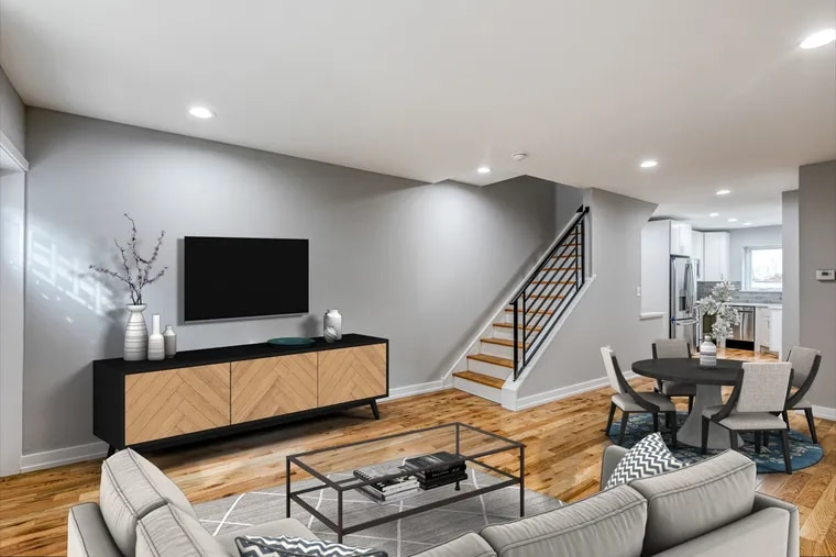 This furniture isn't really in this room. It's been placed virtually to give homebuyers shopping online an idea of how the room could look and how much furniture would fit.
