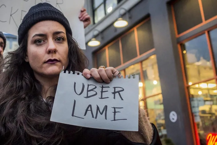 Dozens protest outside Uber's headquarters in Long Island City, the day before Uber CEO, Travis Kalanick, was to met with Donald Trump as part of his advisory council. Just prior to the protest's start, and after thousands deleted the ride-sharing service's app over the weekend, Kalanick announced he would not join Trump's advisory team. (Michael Nigro/Pacific Press/ ZUMA Wire/TNS)