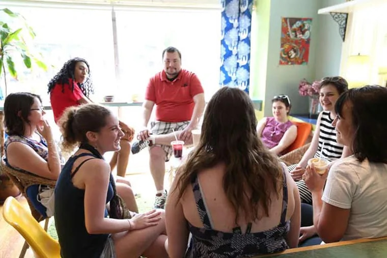 Dakota Fisher-Vance (left), co-founder of the Young Adult Cancer Connection, talks with other survivors during a recent gathering at the Juice Room in Germantown.