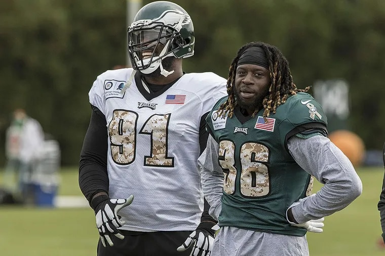 Eagles all-pro defensive tackle Fletcher Cox has a laugh with running back Jay Ajayi.