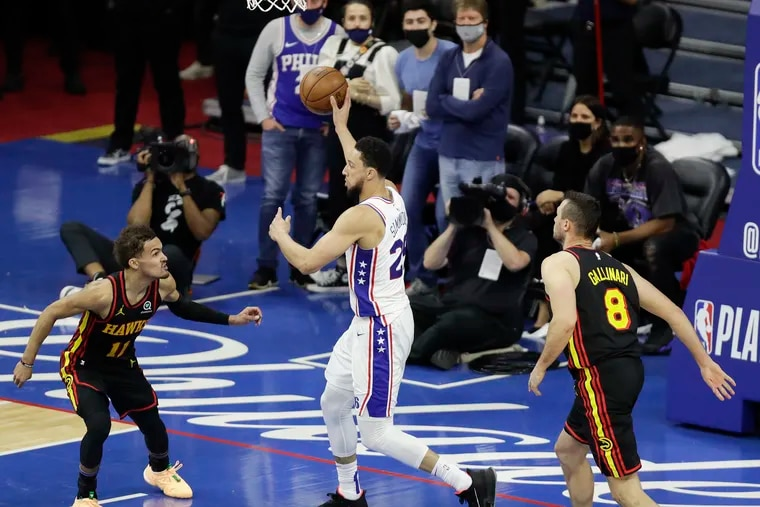 Sixers guard Ben Simmons passes the basketball against Atlanta Hawks guard Trae Young and forward Danilo Gallinari during the fourth quarter in Game 7 of the NBA Eastern Conference playoff semifinals on Sunday, June 20, 2021 in Philadelphia.