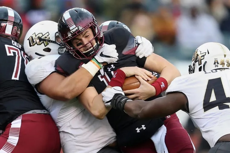 UCF defensive lineman Joey Connors (91) sacks Temple quarterback Frank Nutile (18) in the third quarter of a game at Lincoln Financial Field on Saturday, Nov 18, 2017. Temple lost 45-19.