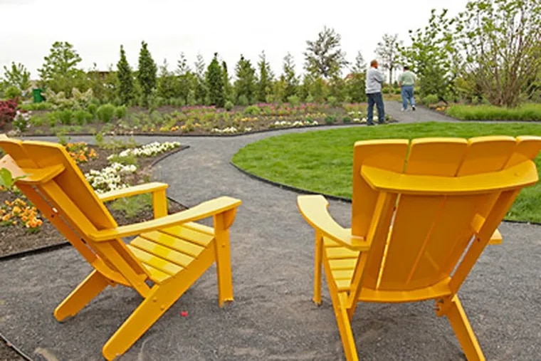Bright Adirondack chairs await strollers in a wild section; they're hardly the only spots of color in the new H.O. Smith Botanic Gardens at Penn State in State College, opened in April. (Michael Bryant / Staff Photographer)