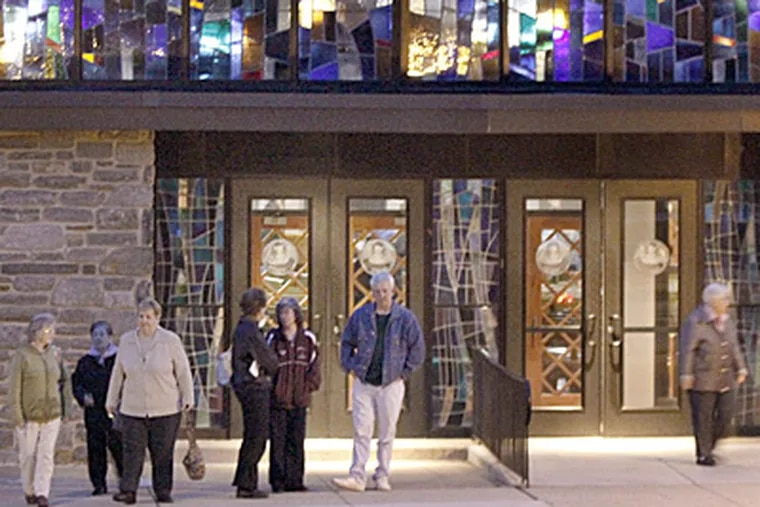 Parishioners leave after gathering Tuesday to discuss how to get priest Msgr. Michael Flood reinstated at St. Luke the Evangelist Church in Glenside. (Elizabeth Robertson / Staff Photographer)