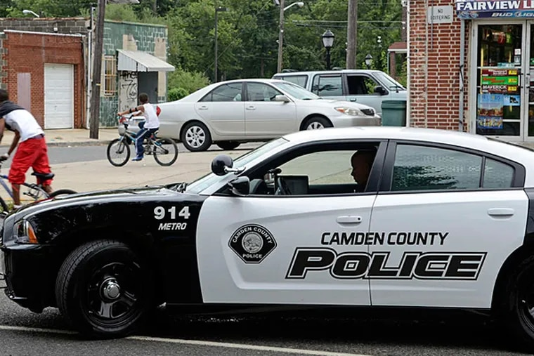 A Camden County police officer makes a stop in Fairview in 2013. Camden will fall off the City Crime Rankings list when the publisher releases its new ratings early next year.