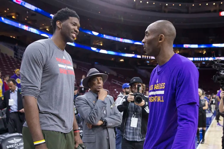 Joel Embiid (left) talked to Kobe Bryant before a December 2015 game at the Wells Fargo Center. It was Bryant's last game against the Sixers.