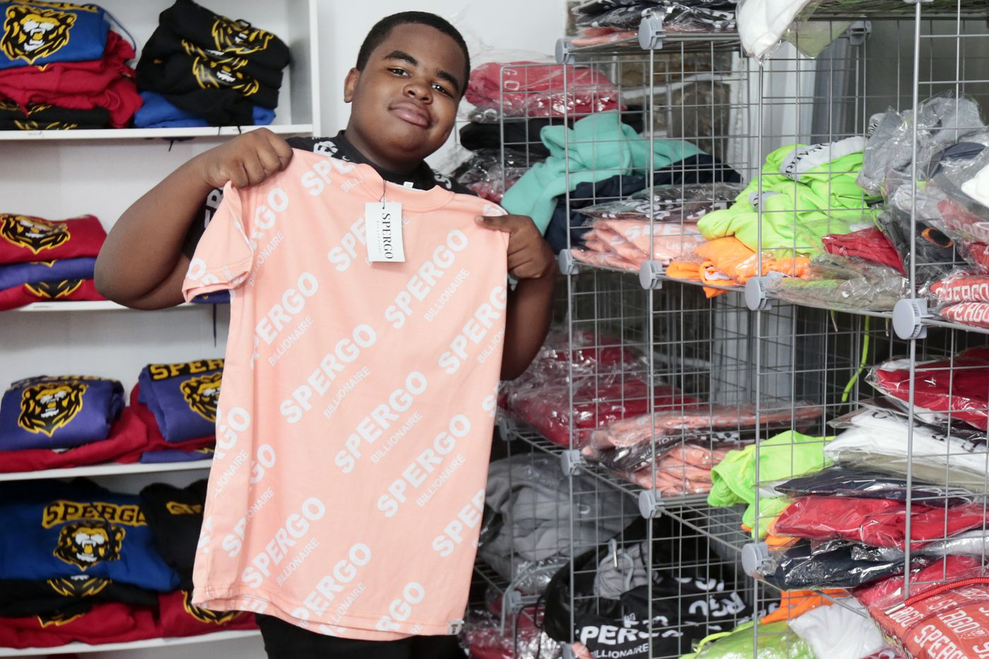 Thirteen-year-old Trey Brown whose fashion line, Spergo, has landed a billboard in Times Square, displays some of his wares at his home in Lansdowne.