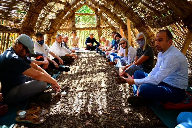 """U.S. service members and Iraqi emigres shared traumatic stories of war during """"Reconciliation — A Healing Encounter"""" at the Schuylkill Center for Environmental Education in Philadelphia. The event was held on the 20th anniversary of 9/11 inside a traditional Iraqi guesthouse called a mudhif, part of an art installation at the center."""
