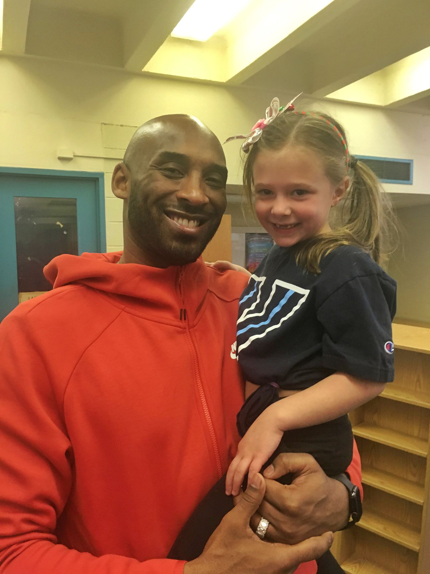 Kobe Bryant and Brynn Downer, daughter of Gregg Downer, who coached Bryant at basketball for four years at Lake Merion High School.