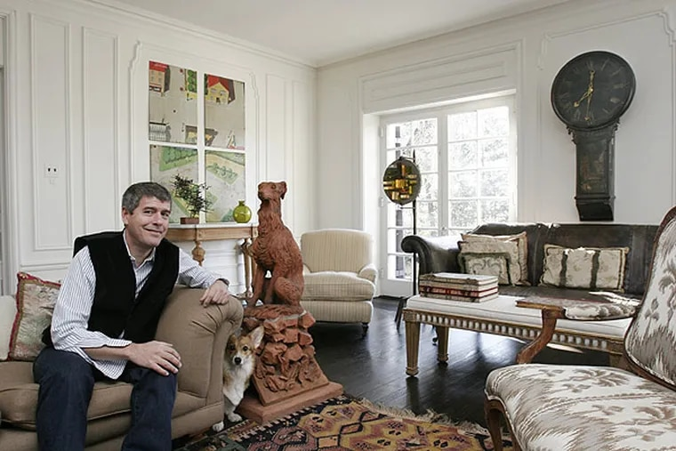Keith Johnson, found-objects buyer for Anthropologie stores, decorates his own home with objects he has discovered, including a stone dog from Ireland and an English tavern clock. Once used as French textile presses, these panels are sold for a new purpose: Wall art.