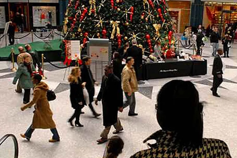 Shoppers and others in the rotunda of the Shops at Liberty Place. (Tom Gralish / Staff)
