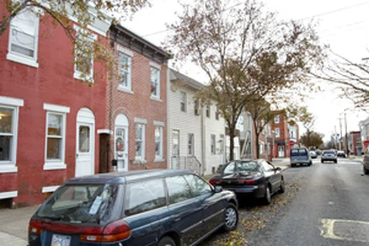 Racist remarks were spray-painted inside home (far left) in Port Richmond.
