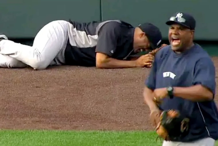 Yankees closer Mariano Rivera , in this image taken from video, lies on the field after twisting his right knee shagging fly balls before Thursday night's game in Kansas City. AP / YES Network
