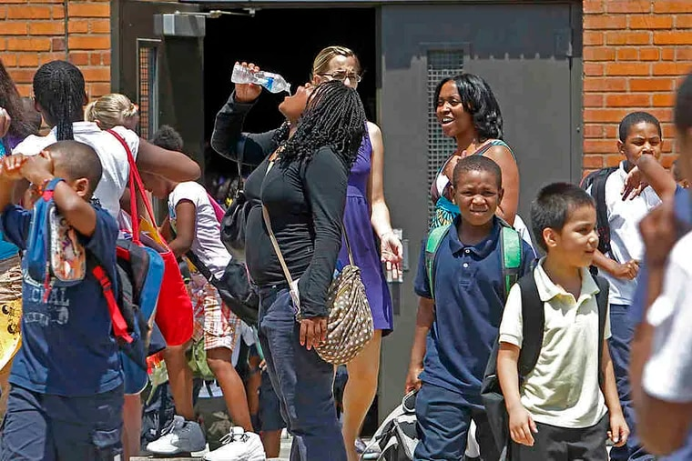 Seventh grader Sherona Kane gulps water after Spring Garden School in North Philadelphia dismissed students early. Philadelphia publicand archdiocesan schools will close at 1:30 again Thursday. Some suburban schools will be closed.