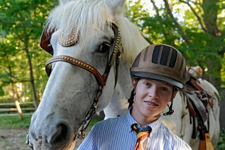 Portrait of Roby Burch, 16, and his horse Jet after school at The Haverford School. (Clem Murray / Staff Photographer)