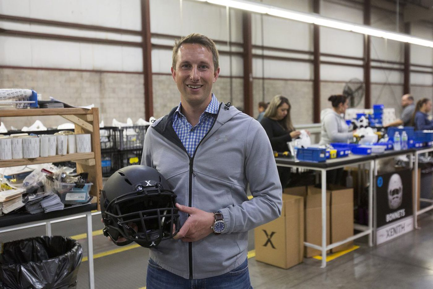 Dan Gilbert-backed football helmet maker is butting heads with big industry players