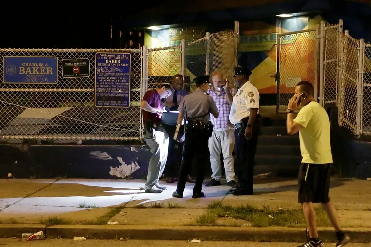 Police investigate the scene at the Charles Baker playground at 54th St. and Landsdowne Ave. in West Philadelphia where seven people were shot during a basketball game just before 9pm on July 13, 2019.