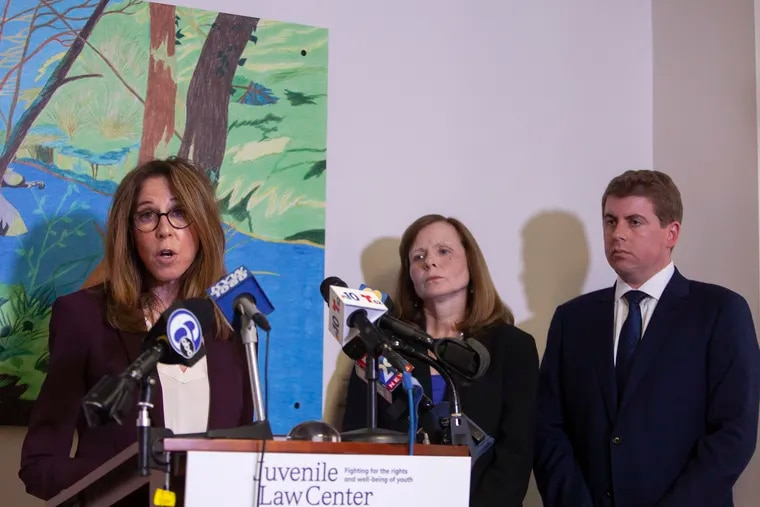 Marsha Levick (left), Chief Legal Officer of the Juvenile Law Center, speaks during a news conference, along with Maura McInerney (center) and Michael McGinley, regarding a lawsuit against Glen Mills Schools and Pa. officials, last week.