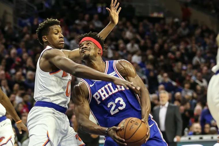 Sixers' Jimmy Butler drives on Knicks' Frank Ntilikina during the 2nd quarter at the Wells Fargo Center in Philadelphia, Wednesday, December 19, 2018.   STEVEN M. FALK / Staff Photographer