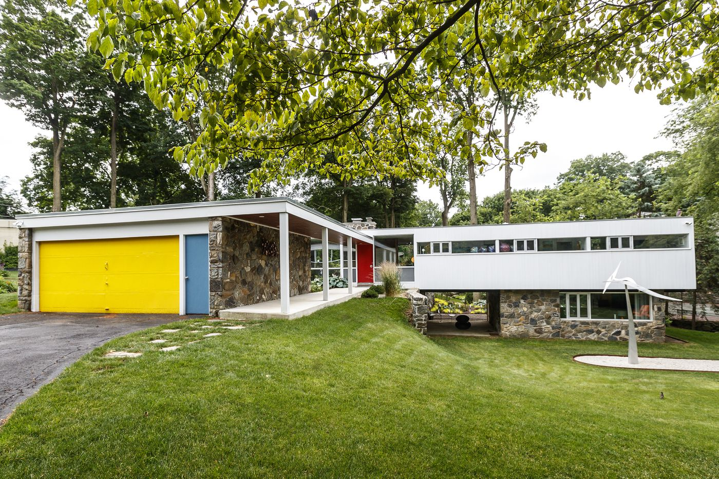 Landscaping creates a bucolic setting for a mid-century ...