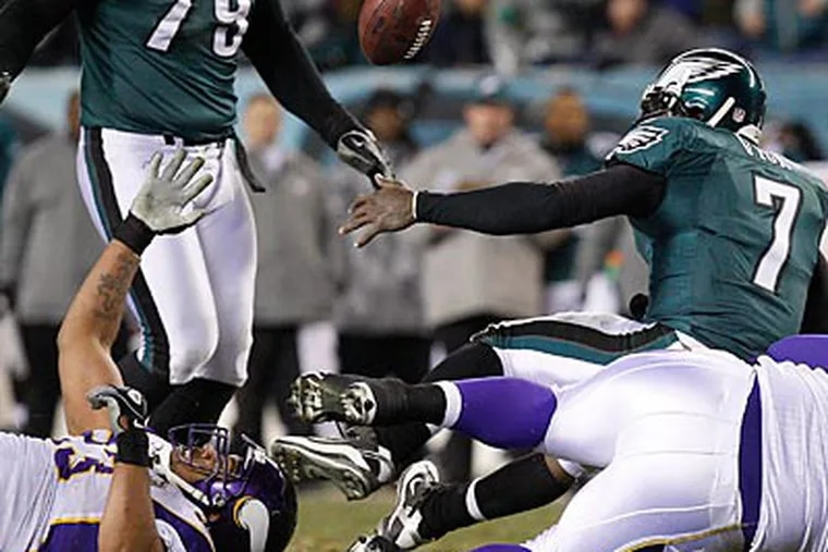 Michael Vick fumbles the ball during the third quarter of last night's loss to the Vikings. (Ron Cortes/Staff Photographer)