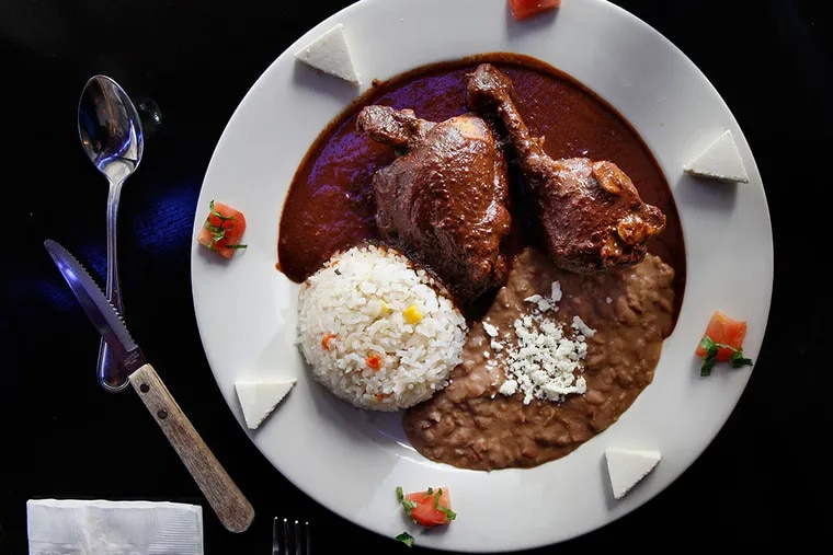 Stewed bone-in chicken in mole poblano, its Mexican chocolate tempered by pasilla pepper spice.