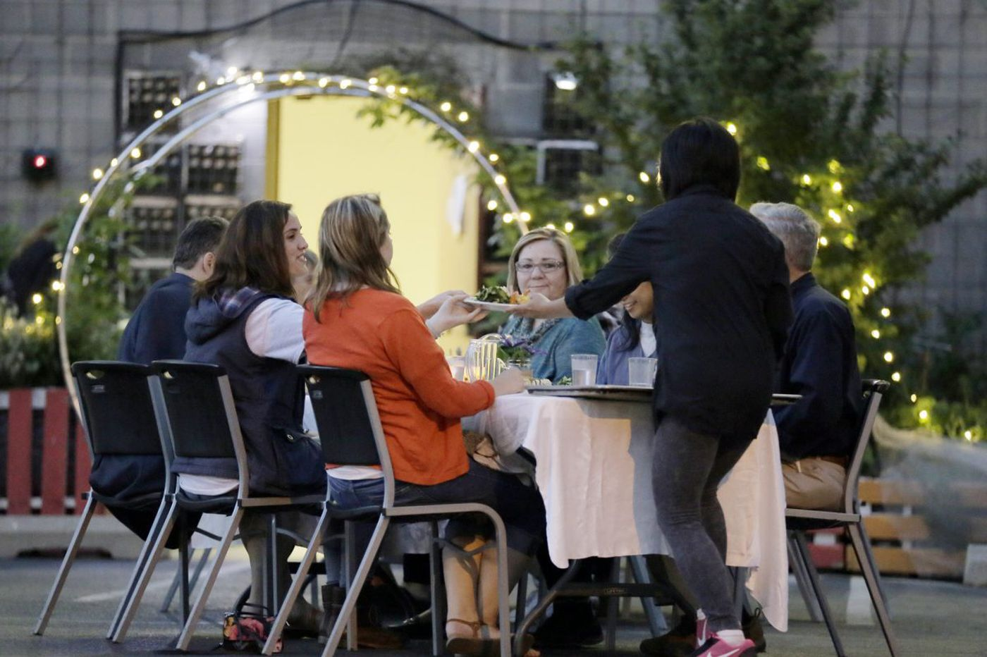 A five-course meal in a parking lot, a lesson in growing food where you live