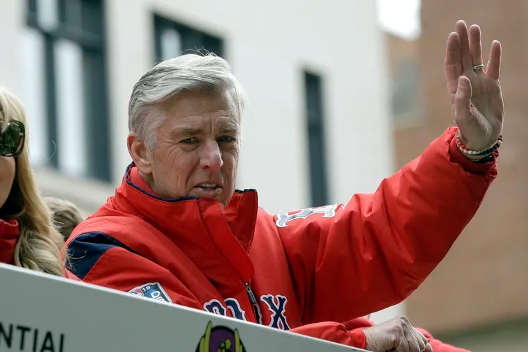 Dave Dombrowski, then the Red Sox president of baseball operations, waves during a parade to celebrate the team's World Series championship over the Dodgers in 2018.