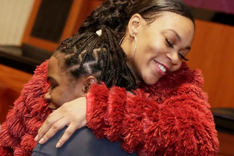 LaTonya Myers (left) and Justina Rockeymore hug as Rockeymore comes up to receive her award during the Probation Awards Ceremony presented by Above All Odds Inc. at the Kline Institute of Trial Advocacy in Philadelphia on Thursday.