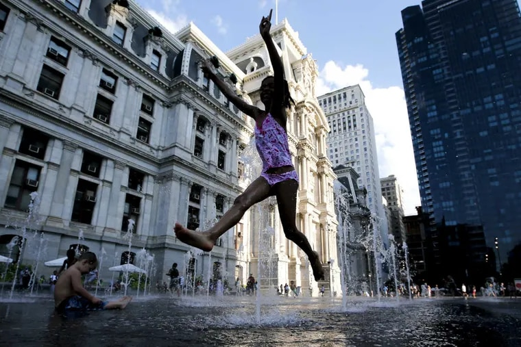 A girl cools off in the fountain at Dilworth Park in Philadelphia.