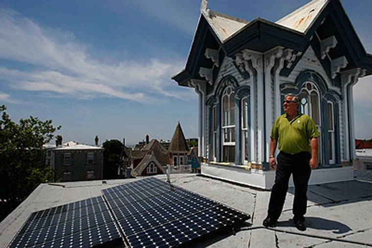 Mark Kulowitz, an owner of the Carroll Villa Hotel, next to newly-installed solar panels. The hotel is the first to have solar panels in the historic district of Cape May. (Michael S. Wirtz / Staff Photographer)