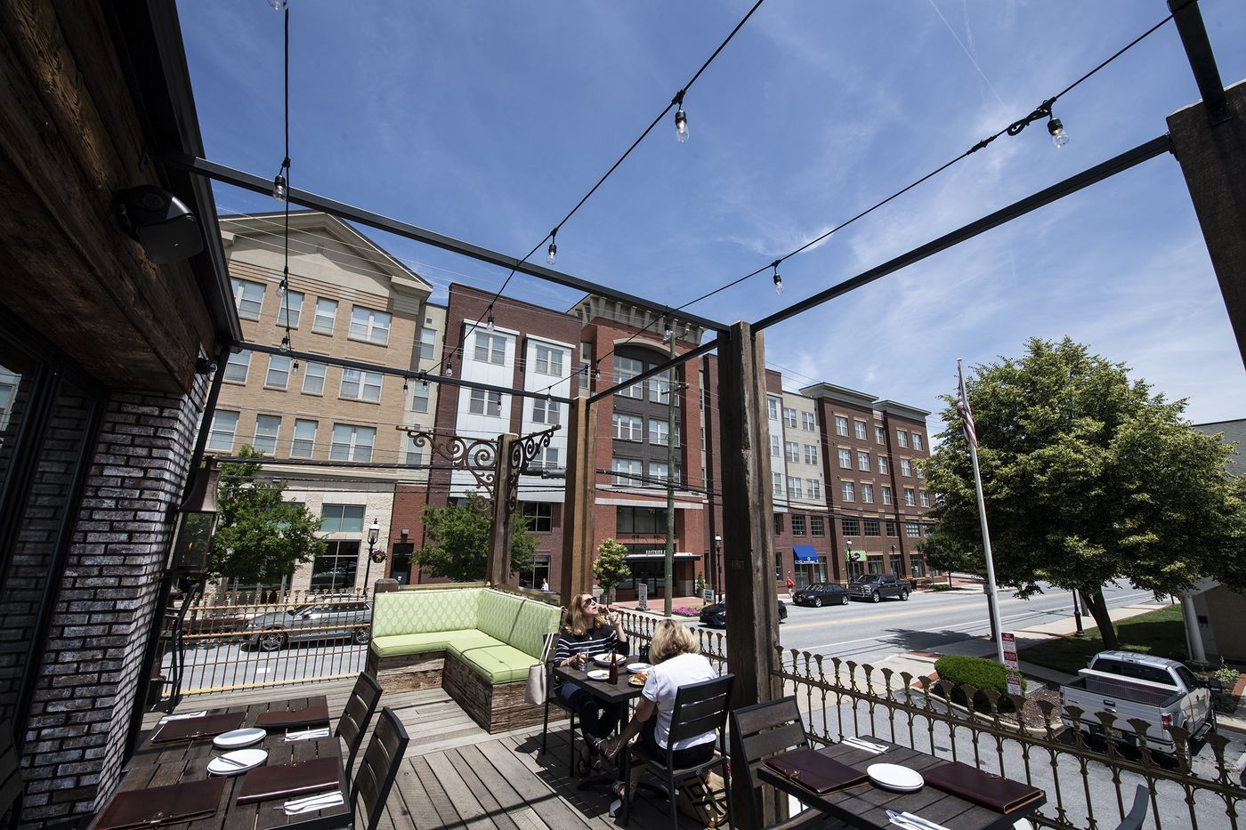 Customers dine on the outdoor deck of the Brick & Brew in Malvern.