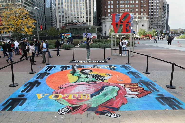 """A mural by chalk artist Bill Strobel at Love Park in Center City Philadelphia encourages people to vote early on Saturday, Oct. 24, 2020. The artwork is part of a """"Vote Early Day"""" campaign by MTV and others to raise awareness of early voting options ahead of election day Nov. 3."""