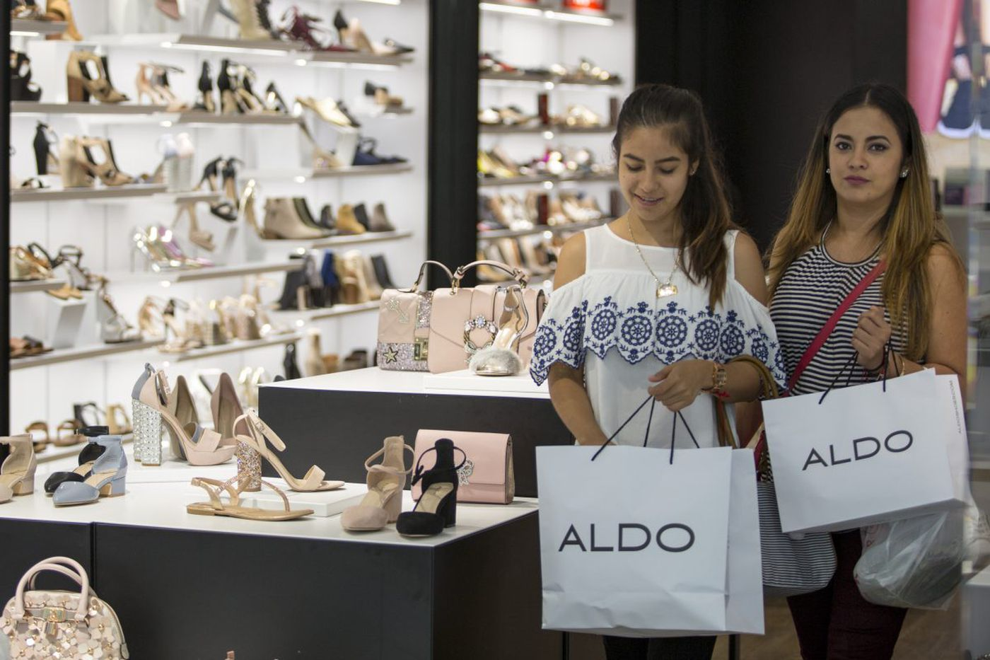 Pairing up: Michael Kors and Jimmy Choo, Aldo and Vince Camuto do the merger thing