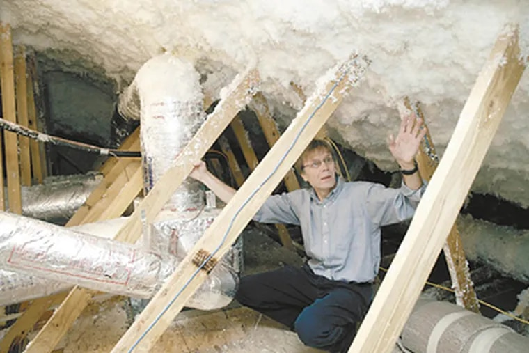 """Government energy-efficiency researcher Jeff Christian in an attic undergoing a """"retrofit"""" to cut energy costs in half. You can't get those savings with caulk alone, but he says it's a great start."""